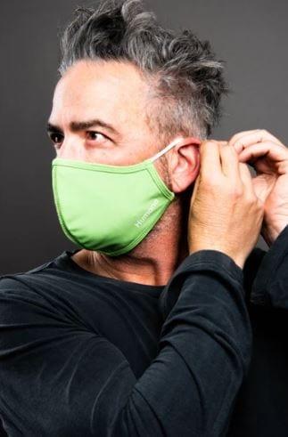 man putting mask on