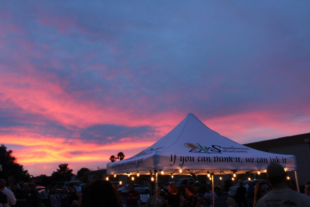 promo tent setup, Arizona sunset in the background