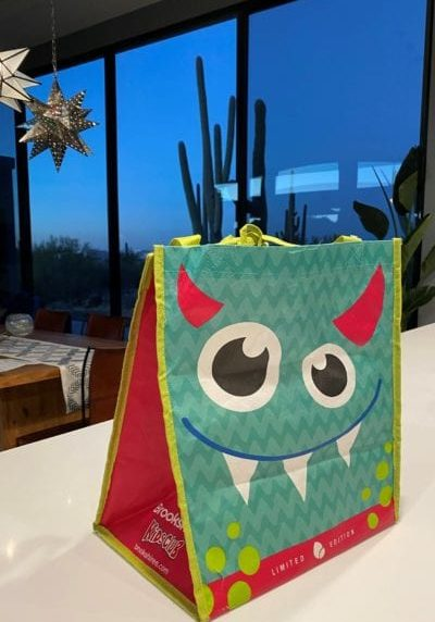 child's reusable lunch back with cute monster design